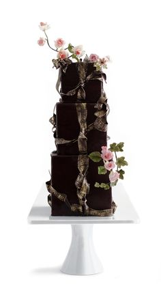 Three stacked chocolate cakes with peach-apricot preserves and milk chocolate fiori di Sicilia buttercream, tied with gold-rubbed brocade sugar ribbons and topped with sugar flowers from Maggie Austin, chef/owner of Maggie Austin Cake Elegant Wedding Cakes, Beautiful Wedding Cakes, Gorgeous Cakes, Wedding Cake Designs, Wedding Cupcakes, Pretty Cakes, Amazing Cakes, Crazy Cakes, Fancy Cakes
