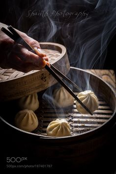 Manti dumplings in bamboo steamer by shaiith