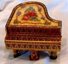 Antique piano music box. Tiny details that required some one who possessed the traits of Patience and Fortitude. Definitely.