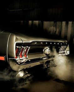 By te taillights, this has to be a 1967 Mustang. That was the best year for these muscle cars!