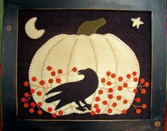 Wool applique crow and pumpkin