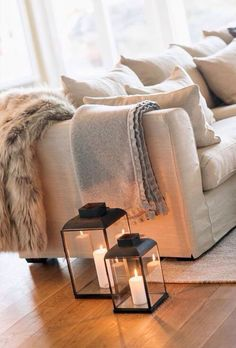 Create a cosy atmosphere in your living room this winter by adding candles in lanterns.