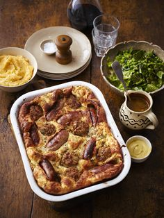 Proper winter food for the weekend - Sausage & stuffing toad-in-the-hole with onion gravy! Serve with mash, green veg & mustard. Recipe at online Bbc Good Food Recipes, Lunch Recipes, Yummy Food, Sunday Roast Chicken Recipes, Sausage Stuffing, Onion Gravy, Cottage Pie, Creole Recipes