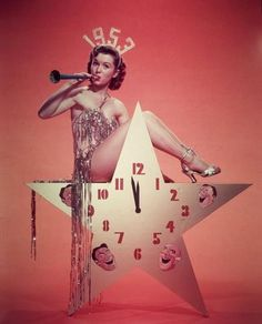 A vintage pinup shot of Hollywood legend Debbie Reynolds bring in the New Year, circa 1953!