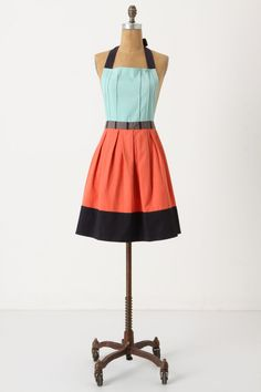 Fairly easy to replicate, more modern feel.  Needs pintucks. Cuisine Couture Apron - Anthropologie.com