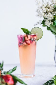 Honey-sweetened limeade with strawberries and lime- great, refreshing drink for a fabulous summer party!