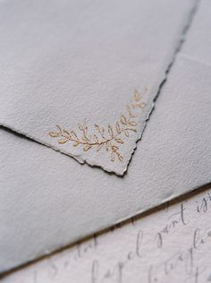 Delicate gold embossing on letter closure