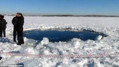 The 20-ft-wide hole in the ice of a frozen lake was created by the falling fragments of the Chelyabinsk meteor