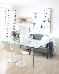 modern eclectic dining room with blue, black and white accents