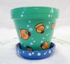 Cute LIL FISHES! Terracotta Pot and Saucer! Hand painted Garden Decor  Ceramics and Pottery  Home Decor  Pot  hand painted  garden decor  cute  terracotta  fish  goldfish  planter  handmade home decor  pot  plant pot  succulent planter  cute planter