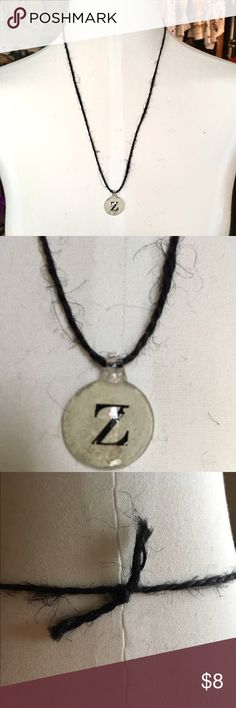 Handmade Black Twine Initial 'Z' Necklace Beautiful handmade black twine necklace featuring a silver-coated beige pendant with the initial 'Z' in the center. Approx. 12 inches, including pendant. Only one available. Handmade Jewelry Necklaces