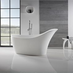 A solid surface freestanding bath, the Jura slipper bath has an extended backrest to ensure full head support.
