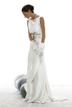 Brides: Le Spose Di Gi�. Halter neck, mermaid skirt. Blouse top, with train and bow in the back.