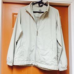 Cabelas jacket Light weight wind breaker type jacket.  Zipper front with two pockets.  100% polyester.  Machine wash cold, tumble dry low. Cabelas Jackets & Coats