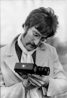 /\ /\ . John Lennon