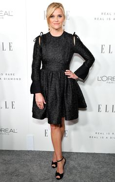 Reese Witherspoon in a Calvin Klein black long-sleeve mini dress
