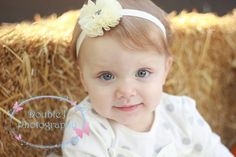 Jewel Flower Baby and Child Headband available in Multiple Solid Colors. This Hair Accessory for Girls fits Infants, Toddlers, and Children. Headband is a Soft Satin Elastic Material that stretches to fit. ThePrincessExpress.com Photography Credit: Double J Photography