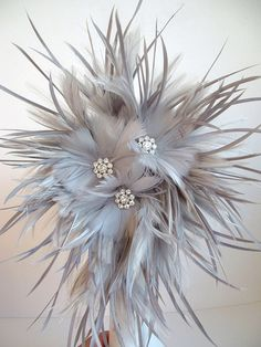 this is listing for one bouquet made feathers, and feather flowers and diamanté. You can choose the colours for the feathers,and trims. Please convo me to discuss the details. Bouquet En Cascade, Feather Bouquet, Diy Bouquet, Bride Bouquets, Feather Wreath, Feather Hair, Feather Dress, Handmade Flowers, Diy Flowers