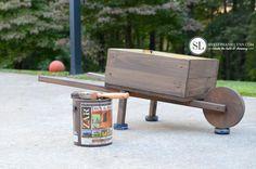 How to Make a Wooden Wheelbarrow Planter   fall wheelbarrow outdoor pumpkin display - bystephanielynn