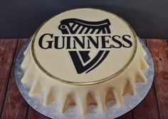"""Beer Bottlecap Groom's Cake - This was a fairly easy cake to make, but it makes a big impact.  And for groom's cakes, they are selling like hotcakes (for me anyway).  I have another one on the books and 2 more quoted as of now.  The flavors of this cake were inspired by the """"Irish Car Bomb"""" drink.  There's Guinness stout in the chocolate cake, Jameson whiskey in the ganache, and Bailey's Irish cream in the buttercream.  The picture may not reflect it, but this is a pretty big cake, with ..."""