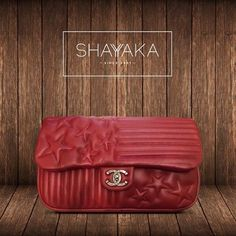 Chanel Red Flap Bag with Stars | 20 x 30 x 7.5cm | Paris Dallas 2014 Collection | Available Now For Immediate Delivery  For inquiries, please contact sales@shayyaka.com or +961 71 594 777 (Call, SMS, WhatsApp, or iMessage) or Direct Message on Instagram (@Shayyaka). Guaranteed 100% Authentic | Worldwide Shipping | Credit Cards or Bank Transfer