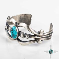 I am a big fan of native American jewelry. I love the turquoise in the middle of this bracelet. The overall design is quite elegant.
