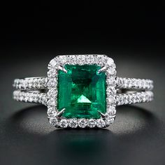 An extra-bright and vibrant, deep, rich green Colombian emerald weighing 1.43 carats is framed by tiny twinkling full-cut diamonds that trail half-way down the doubled platinum shank. A gorgeous and gemmy emerald ring that can easily serve as a non-conformist engagement ring.