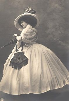 Very feminine, and the hat and purse  are great pieces with this dress