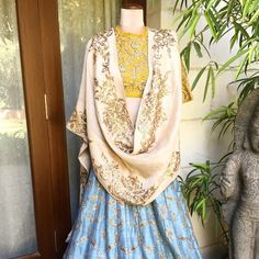 Ivory X Mustard X Sky Blue! Beautiful sky blue color lehenga and mustard color boat neck blouse with ivory dupatta with hand embroidery gold thread work by  Jayanti Reddy . 25 January 2018