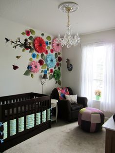 I LOVE the 3D flower wall AND the paper lantern night light in this nursery...