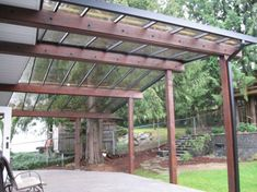Patio cover with corrugated metal roofing. Structural