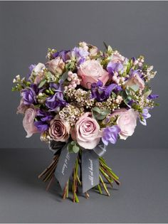Wild At Heart - Winter Meadow Bouquet  - A beautiful array of dusky purple roses, clematis, wax flower, freesia , snowberries and seasonal foliage.
