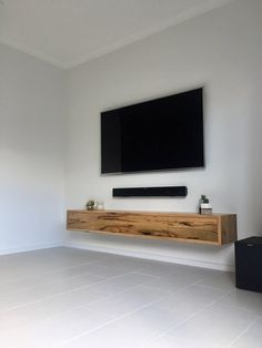 We first made the 'Collie' Marri TV unit back in 2014 for Josh & Charlotte on The Block. Since then it has been super popular as the simple… Living Room Tv, Home And Living, Tv On Wall Ideas Living Room, Tv Wall Decor, Wall Tv, Tv Wall Units, Wall Mounted Tv Unit, Tv Units, Wall Mounted Entertainment Unit