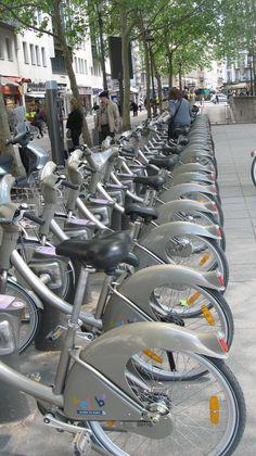 Velib of Paris . Let's bike around the city of Paris .  ; )