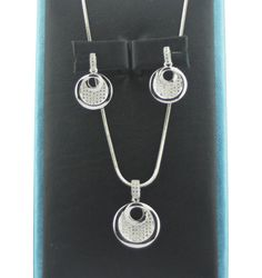 "OFFICE LOOK #MySiaLook  A dazzling Pendant Set with matching earrings embellished with American Diamond in rhodium colour plating! The sets has rhodium finish with beautiful micro pave setting and is apt for the regular wear. Pendant 0.5"" chain 15"" and earrings 0.5"" approx"