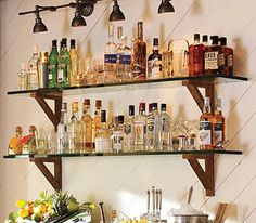 simple, but maybe a little dangerous with those glass shelves... Remember- plan out the lighting...lighting is KEY!!!!  home bar designs - Google Search