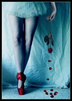 Blood red pointe shoes.