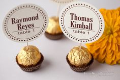 How cute would this be? A Ferrero Rocher candy holding the seating card? I don't like the card shown