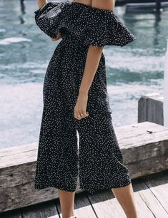 Jumpsuits are great from day to night.   How to add Feminine Ruffles to Your Wardrobe With Flare