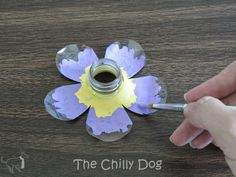 Learn how to create garden art flowers from plastic water bottles with this kid friendly craft tutorial.