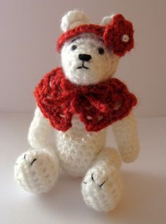 Crocheted in a DK weight acrylic yarn.      NOT a TOY.  White with a red crocheted wrap. Bear