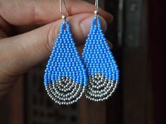 "French blue and silver seed bead teardrop earrings. silver ""dip"" look. beadwork teardrop earrings. blue and silver brick stitch earrings."