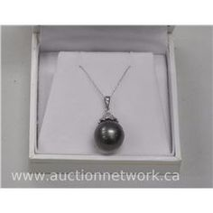 Stamped 18kt White Gold Ladies Fancy Pendant with black Pearl.