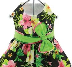 She'll hear the sound of the waves and feel the breezes in her fur when she wears our Twilight Black Hawaiian Hibiscus Designer Dog Dress Matching Leash Included! This bright, flowery, lightweight dress is a tropical delight! Bright green bow at waist. Comes complete with matching leash.  www.beaujax.com
