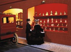 The store window of the porcelain department with genuine Hummel porcelain figurines in the largest miniature department store in the world. Miniature Dollhouse, Miniature Houses, Doll Museum, China Tea Sets, Hessian, Small World, Department Store, Doll Houses