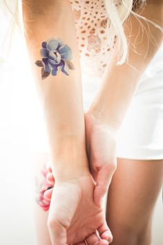 Blue flower temporary tattoo by Sasha Unisex. https://www.tattooyou.com/product/flower-collection/