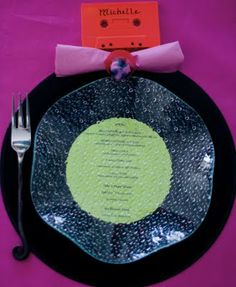 Fun table setting for an 80s party - records as chargers with menu on the label (or not), painted cassettes as nameplates, ring pops as napkin rings, and jelly bracelets as cocktail glass rings/decorations.