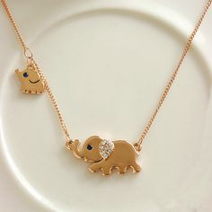 Jewelry: I love the little elephant pendant necklace, and baby elephant, so cute! Fashion gold jewelry 2013 gold pendant necklace for women Elephant Family, Elephant Love, Little Elephant, Small Elephant, Baby Elephants, Elephant Stuff, Elephant Design, Cute Jewelry, Gold Jewelry