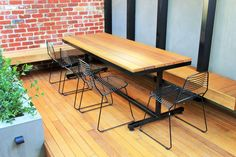 Custom Table with Black Frame & 136 x 32mm Spotted Gum Timbers . By Outdoor Table Creations