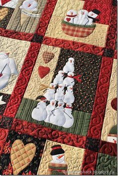 This is Raye's Snowman Country Quilt and it is a pattern by Bunny Hill Designs. All the snowman are hand appliqued by Raye with a beautiful buttonhole stitch! She asked for custom quilting and I h